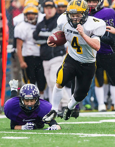 Kyle Grillot - kgrillot@shawmedia.com   Harvard junior Christian Kramer runs the ball during the third quarter of the third-round Class 4A football playoff game between Harvard and Rockford Lutheran Saturday in Rockford. Rockford Lutheran won the game 28-24.