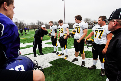 Kyle Grillot - kgrillot@shawmedia.com   Team captains meet with referees during the coin toss before the start of the third-round Class 4A football playoff game between Harvard and Rockford Lutheran Saturday in Rockford. Rockford Lutheran won the game 28-24.