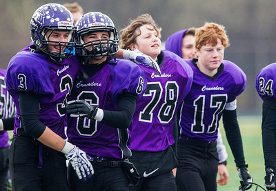 Kyle Grillot - kgrillot@shawmedia.com   The Rockford Lutheran team celebrates after end of the third-round Class 4A football playoff game between Harvard and Rockford Lutheran Saturday in Rockford. Rockford Lutheran won the game 28-24.