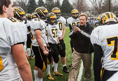 Kyle Grillot - kgrillot@shawmedia.com   Harvard head coach Tim Haak talks with his team during half time of the third-round Class 4A football playoff game between Harvard and Rockford Lutheran Saturday in Rockford. Rockford Lutheran won the game 28-24.