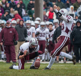 Randy Stukenberg for Shaw Media Danny Meikel holds for Prairie Ridge kicker Chris Eschweiler in the first quarter of the Class 6A playoff game in Rockford Saturday, Nov. 16, 2013. Eschweiler's feild goal gave the Wolves their first score of the game.