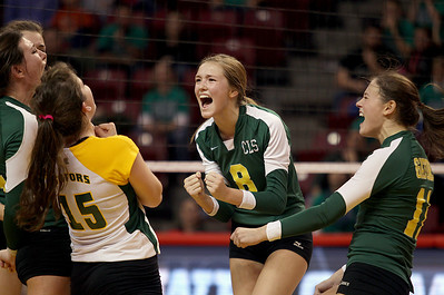 Sarah Nader - snader@shawmedia.com Crystal Lake South's Cassy Sivesind (center) celebrates a point during Saturday's third-place match against New Trier at the IHSA Class 4A state final at Illinois State University in Normal, IL November 16, 2013. Crystal Lake South lost to New Trier and finished fourth place at state.