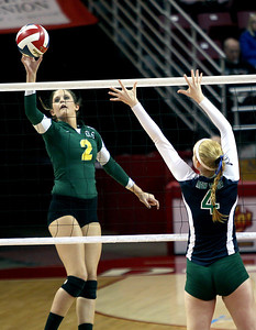 Sarah Nader - snader@shawmedia.com Crystal Lake South's Emma Burkle (left) taps the ball over during Saturday's third-place match against New Trier at the IHSA Class 4A state final at Illinois State University in Normal, IL November 16, 2013. Crystal Lake South lost to New Trier and finished fourth place at state.