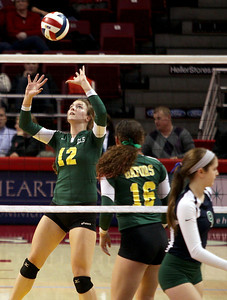 Sarah Nader - snader@shawmedia.com Crystal Lake South's Nicole Slimko sets the ball during Saturday's third-place match against New Trier at the IHSA Class 4A state final at Illinois State University in Normal, IL November 16, 2013. Crystal Lake South lost to New Trier and finished fourth place at state.