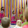 (Left to right) Aashika Jain, 7, Anishka Jain, 4 and Saraya Singh, 6, perform a Bollywood-style dance as part of the Geneva Public Library's Passport Program about India Tuesday afternoon.