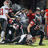 Aurora Christian's Jake Smith (50) and Jack Burke (51) tackle Stillman Valley's Connor McNames (4) for a loss<br /> during the 3A semi-final football game at Aurora Christian High School in Aurora , IL on Saturday, November 23, 2013 (Sean King for Shaw Media)