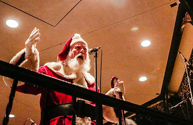 Kyle Grillot - kgrillot@shawmedia.com   A man portraying Santa Claus gives a speech during the Lighting of the Square Friday in Woodstock.