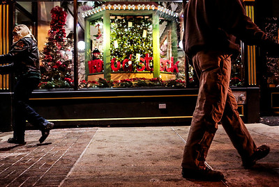 Kyle Grillot - kgrillot@shawmedia.com   Pedestrians walk along East Jackson Street during the Lighting of the Square Friday in Woodstock.
