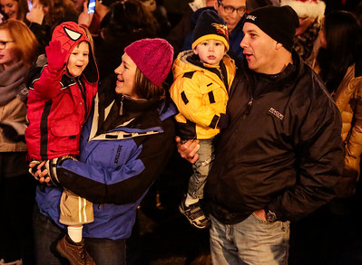 Kyle Grillot - kgrillot@shawmedia.com   Jack Dunderdale, 4, of Crystal Lake (left) cheers with his family Heidi, Liam, 2, and Tim as the Woodstock Square is lit during the Lighting of the Square Friday in Woodstock.