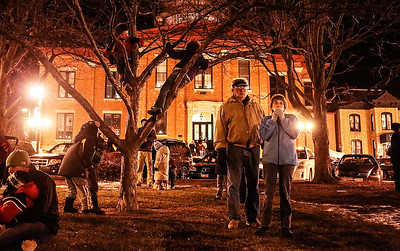 Kyle Grillot - kgrillot@shawmedia.com   Spectators gather in Woodstock Square during the Lighting of the Square Friday in Woodstock.