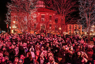 Kyle Grillot - kgrillot@shawmedia.com   The crowd watches as a firework explodes above them during the Lighting of the Square Friday in Woodstock.