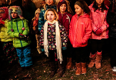 Kyle Grillot - kgrillot@shawmedia.com   Children watch as a man dressed as Santa Claus makes a speech during the Lighting of the Square Friday in Woodstock.