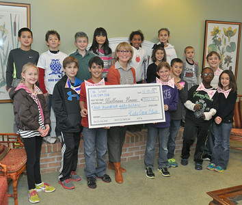 Kids Care Club brings big check