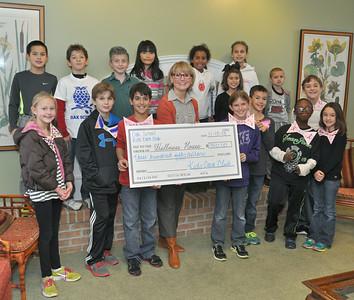 Kids Care Club brings big check
