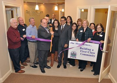 Dental office ribbon cutting