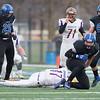 Hononegah Quarterback Daytona Chandl (17) is sacked by Geneva's Matthew Loberg (9) during their 7A playoff game at Geneva High School in Geneva, IL on Saturday, November 08, 2014 (Sean King for Shaw Media)