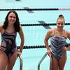 Jeff Krage – For Shaw Media<br /> St. Charles East swimmer's Isabel Herb, left, and Jordan Morling pose for a portrait before Monday's practice. <br /> St. Charles 11/10/14