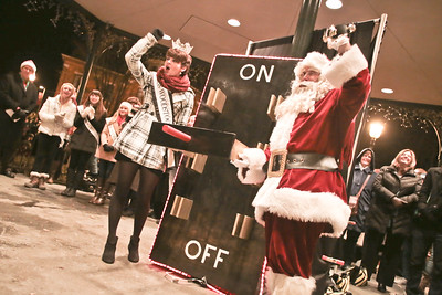 Michelle LaVigne/ For Shaw Media Miss Woodstock, Nora Brown and Santa Clause, prepare to flip the switch and light up the Woodstock square fduring the Holiday lighting event on Friday, November 27th, 2015.
