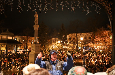 Michelle LaVigne/ For Shaw Media Paul Raush directs the Woodstock Community Choir as they sing carols prior to the lighting of the Woodstock square on Friday, November 27th, 2015.