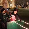 Noah Wood (left) 3, and Tyler wood, 5, of Batavia play on Santa's sleigh during the Batavia celebration of lights festival at Batavia Riverwalk in Batavia, IL on Sunday, November 29, 2015 (Sean King for Shaw Media)