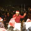 John Heath conducts the Batavia community band during the Batavia celebration of lights festival at Batavia Riverwalk in Batavia, IL on Sunday, November 29, 2015 (Sean King for Shaw Media)
