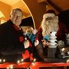 Mayor Jeff Schielke and Santa Claus light the holiday tree during the Batavia celebration of lights festival at Batavia Riverwalk in Batavia, IL on Sunday, November 29, 2015 (Sean King for Shaw Media)