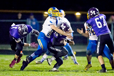 KKoontz - For Shaw Media Johnsburg's Austin Butler (25) sacks Manteno quarterback Gavin Zimbelman in the Class 4A second round playoff game Friday, Nov. 4, 2016 in Manteno  Johnsburg won, 49-35.