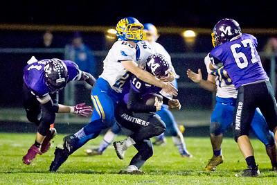 KKoontz - For Shaw Media Johnsburg's Austin Butler (25) sacks Manteno quarterback Gavin Zimbelman in the Class 4A second round playoff game Friday, Nov. 4, 2016 in Manteno  Johnsburg won, 49-35.