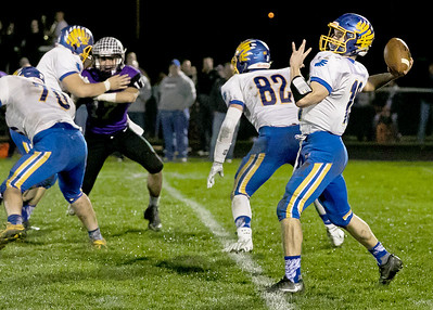 KKoontz - For Shaw Media Johnsburg quarterback Riley Buchanan throws a pass downfield in the Class 4A second round playoff game Friday, Nov. 4 ,2016 in Manteno.