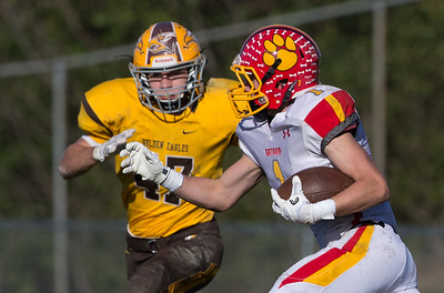 Batavia's Jarred Martin (1) catches a pass in front of Jacobs' Jacob Hanfeld (47) Saturday, Nov. 5, 2016 during the Class 7A second round playoff game at Jacob High School in Algonquin IL. Jacobs wins 28-14 and advances to the quarterfinal round. KKoontz- for Shaw Media