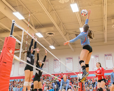 Marian Central's Brenna Koch (9) goes for the spike against Rosary Saturday, Nov. 5, 2016 at the Class 3A Super Sectionals held at Marian Central Catholic High School in Woodstock IL.  Marion defeats Rosary High School to advance to the State Semifinals.  KKoontz- for Shaw Media