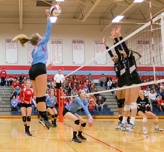 Marian Central's McKayla Wuensch (7) spikes above the Rosary defenders Saturday, Nov. 5, 2016 at the Class 3A Super Sectionals held at Marian Central Catholic High School in Woodstock IL.  Marion defeats Rosary High School to advance to the State Semifinals.  KKoontz- for Shaw Media