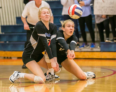 Rosary's Lauren Brummel (12) digs out a serve in front of teammate Erin Burke (15) Saturday, Nov. 5, 2016 at the Class 3A Super Sectionals held at Marian Central Catholic High School in Woodstock IL.  Marion went on to win over Rosary High School to advance to the State Semifinals.  KKoontz- for Shaw Media