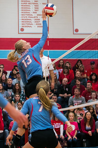 Marian Central's Emily Radecki (13) goes for the spike against Rosary Saturday, Nov. 5, 2016 at the Class 3A Super Sectionals held at Marian Central Catholic High School in Woodstock IL.  Marion defeats Rosary High School to advance to the State Semifinals.  KKoontz- for Shaw Media