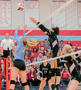 Rosary's Maya Sullivan (16) blocks a spike above Marian's McKayla Wuensch (7) Saturday, Nov. 5, 2016 at the Class 3A Super Sectionals held at Marian Central Catholic High School in Woodstock IL.  Marion defeats Rosary High School to advance to the State Semifinals.  KKoontz- for Shaw Media