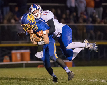 Genoa – Kingston's Klint Wewetzer (16) sacks Johnsburg's quarterback Riley Buchanan (10) in the Class 4A Quarterfinal playoff game held Friday, Nov. 11th, 2016 at Johnsburg High School.  Johnsburg went on to defeat Genoa Kingston 42- 13 advancing them to the state semifinals. KKoontz- For Shaw Media