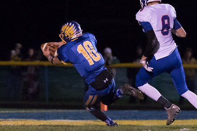 Johnsburg's Riley Buchanan (10) scores on a 28 yard run in the Class 4A Quarterfinal playoff game held Friday, Nov. 11th, 2016 at Johnsburg High School.  Johnsburg went on to defeat Genoa Kingston 42- 13 advancing them to the state semifinals. KKoontz- For Shaw Media