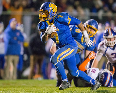 Johnsburg's Alex Peete (7) breaks away for a 21 yard touchdown run in the Class 4A Quarterfinal playoff game held Friday, Nov. 11th, 2016 at Johnsburg High School.  Johnsburg went on to defeat Genoa Kingston 42- 13 advancing them to the state semifinals. KKoontz- For Shaw Media