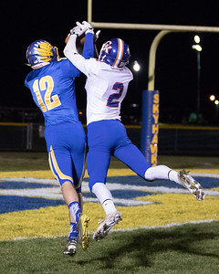 Johnsburg's Adam Jayko (12) intercepts intended for Genoa-Kingston receiver Zach Miller (2) in the Class 4A Quarterfinal playoff game held Friday, Nov. 11th, 2016 at Johnsburg High School.  Johnsburg went on to defeat Genoa Kingston 42- 13 advancing them to the state semifinals. KKoontz- For Shaw Media
