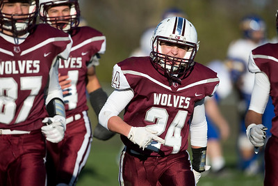 Jackson Willis (24) of Prairie Ridge celebrates after scoring a touchdown during the third quarter of their Class 6A quarterfinal playoff game against Lake Forest at Prairie Ridge High School on Saturday, November 12, 2016 in Crystal Lake, Ill. The Wolves defeated the Scouts 71-7.  John Konstantaras photo for the Northwest Herald