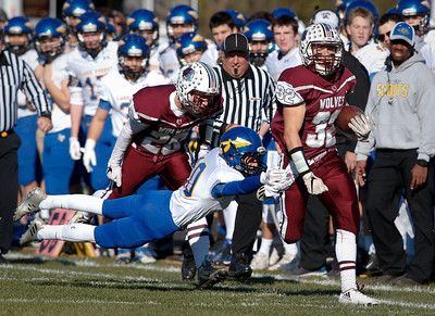 Zach Gulbransen (32) of Prairie Ridge breaks a tackle by Jack Brush (10) of Lake Forest for a touchdown on the opening kickoff of their Class 6A quarterfinal playoff game at Prairie Ridge High School on Saturday, November 12, 2016 in Crystal Lake, Ill. The Wolves defeated the Scouts 71-7.  John Konstantaras photo for the Northwest Herald