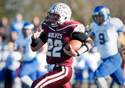 Samson Evans (22) of Prairie Ridge runs for a touchdown during the second quarter of their Class 6A quarterfinal playoff game against Lake Forest at Prairie Ridge High School on Saturday, November 12, 2016 in Crystal Lake, Ill. The Wolves defeated the Scouts 71-7.  John Konstantaras photo for the Northwest Herald