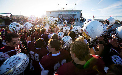 Prairie Ridge players celebrate their Class 6A quarterfinal playoff win over Lake Forest at Prairie Ridge High School on Saturday, November 12, 2016 in Crystal Lake, Ill. The Wolves defeated the Scouts 71-7.  John Konstantaras photo for the Northwest Herald