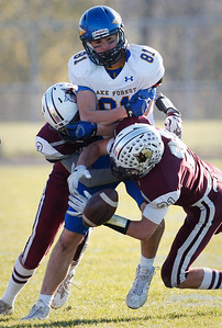James Queen (3) and F. Joseph Perhats (21) of Prairie Ridge break up a pass intended for Reed Thomas (81) of Lake Forest during the second quarter of their Class 6A quarterfinal playoff game at Prairie Ridge High School on Saturday, November 12, 2016 in Crystal Lake, Ill. The Wolves defeated the Scouts 71-7.  John Konstantaras photo for the Northwest Herald