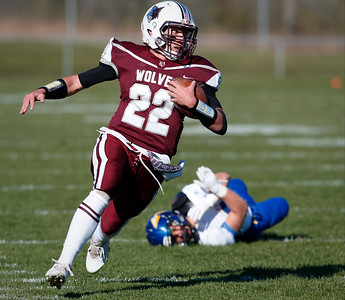 Quarterback Samson Evans (22) of Prairie Ridge runs for a first down during the first quarter of their Class 6A quarterfinal playoff game against Lake Forest at Prairie Ridge High School on Saturday, November 12, 2016 in Crystal Lake, Ill. The Wolves defeated the Scouts 71-7.  John Konstantaras photo for the Northwest Herald