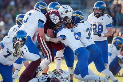 Samson Evans (22) of Prairie Ridge plows his way through the Lake Forest defense for a touchdown during the second quarter of their Class 6A quarterfinal playoff game at Prairie Ridge High School on Saturday, November 12, 2016 in Crystal Lake, Ill. The Wolves defeated the Scouts 71-7.  John Konstantaras photo for the Northwest Herald