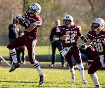 Daniel Renteria (7) of Prairie Ridge intercepts a pass and returns it for a touchdown with no time no the clock in the second quarter of their Class 6A quarterfinal playoff game against Lake Forest at Prairie Ridge High School on Saturday, November 12, 2016 in Crystal Lake, Ill. The Wolves defeated the Scouts 71-7.  John Konstantaras photo for the Northwest Herald