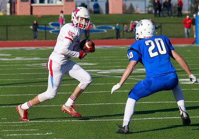 Candace H. Johnson-For Shaw Media Marian Central's A.J. Golembiewski tries to get past Vernon Hills defender, Jake Morris, as he runs the ball in the third quarter during the Class 5A state quarterfinals game at Vernon Hills High School.