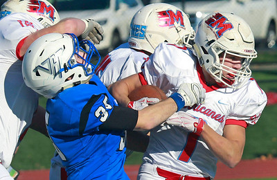 Candace H. Johnson-For Shaw Media Marian Central's Brian Niemaszek looks to break the tackle attempt by Vernon Hills Trey Hommer in the second quarter during the Class 5A state quarterfinals game at Vernon Hills High School.