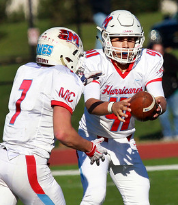 Candace H. Johnson-For Shaw Media Marian Central's Brian Niemaszek takes a hand off from quarterback, Patsy Ricciardi, against Vernon Hills in the second quarter during the Class 5A state quarterfinals game at Vernon Hills High School.